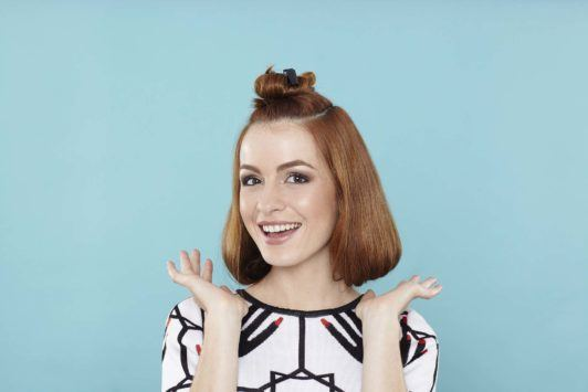 young woman with faux bob on red hair