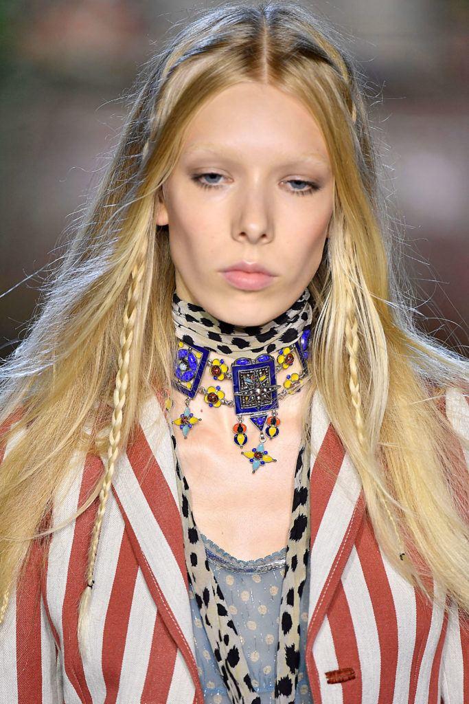 Woman wearing hidden festival braids.