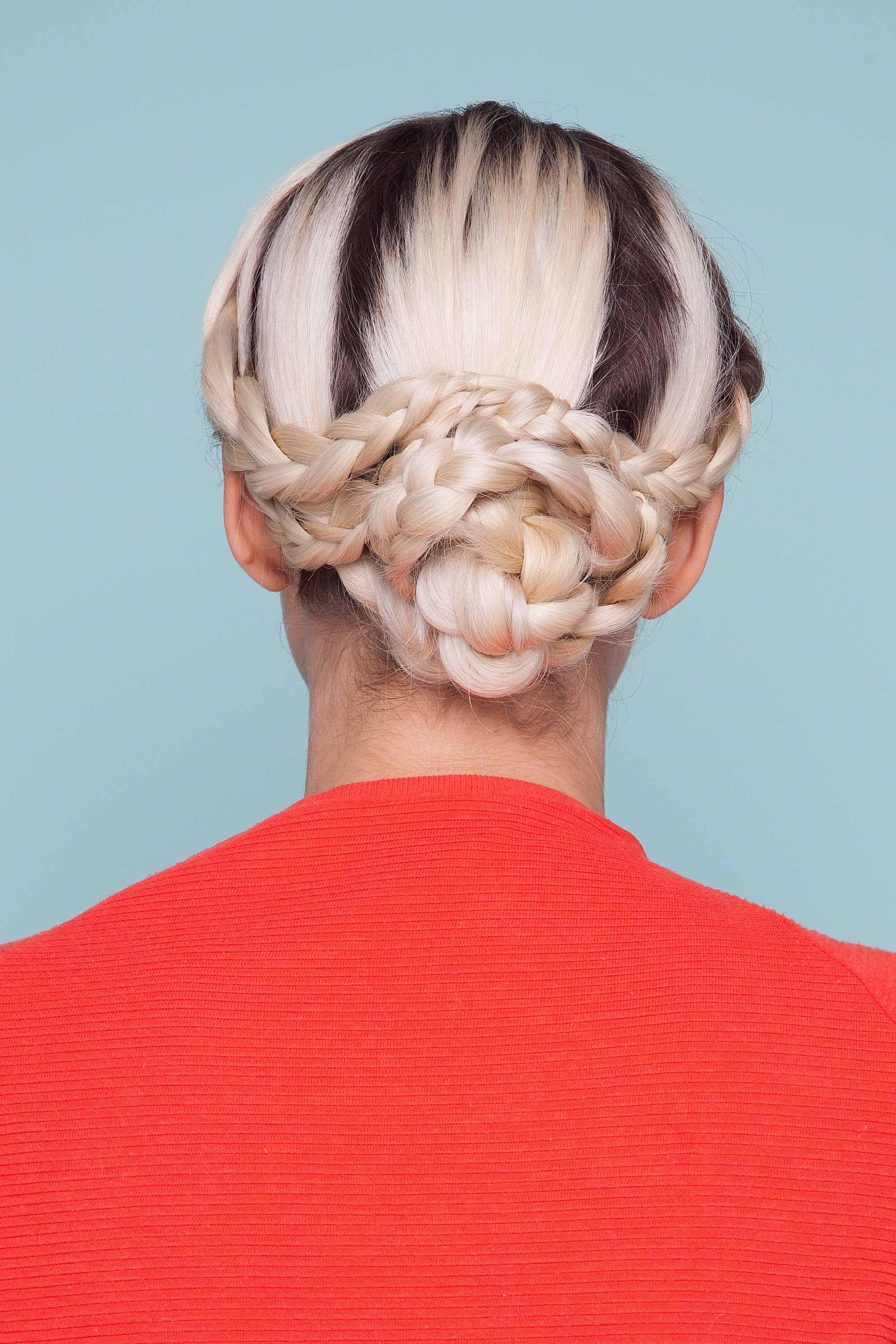 Woman wearing festival braids in an updo.