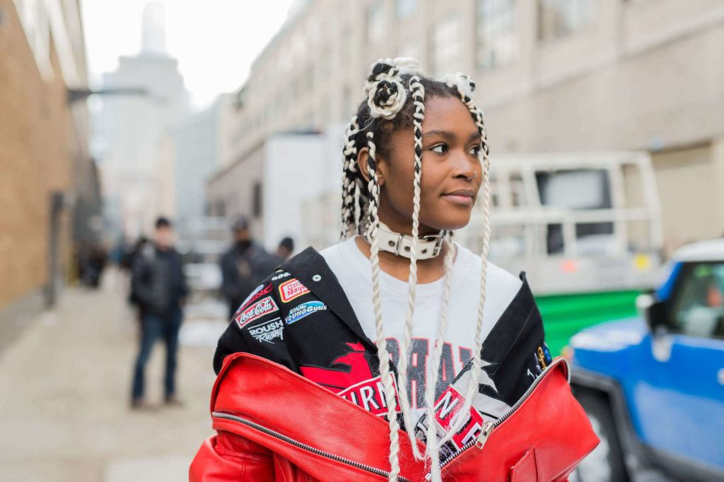 Woman wearing festival braids in a half updo.
