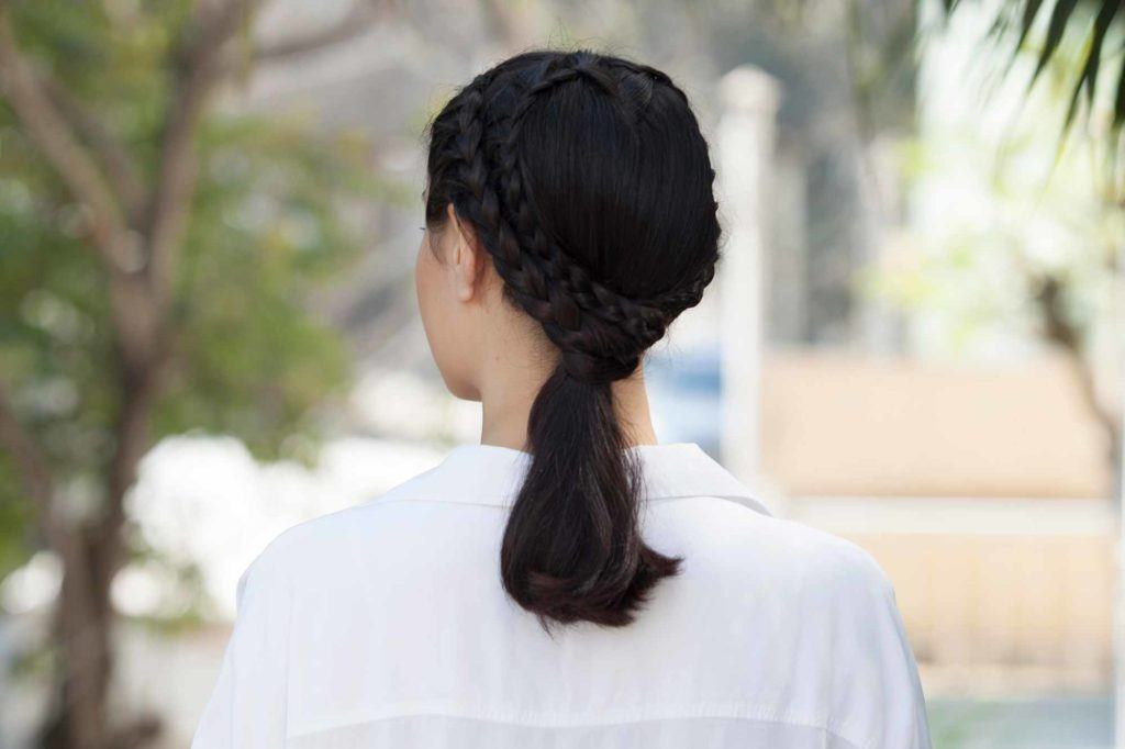 a braided ponytail hair of a woman rear view