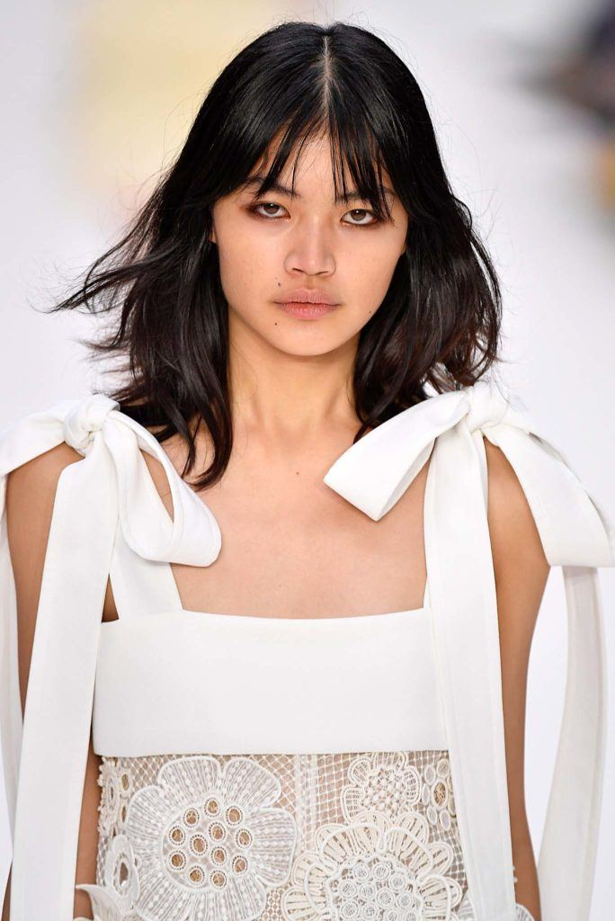 French-Girl Hair: Why We Love Medium Layered Hairstyles with a Fringe