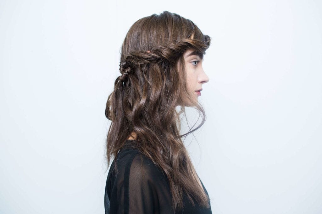 New Hair Trends include half up, half down braided updo looks.