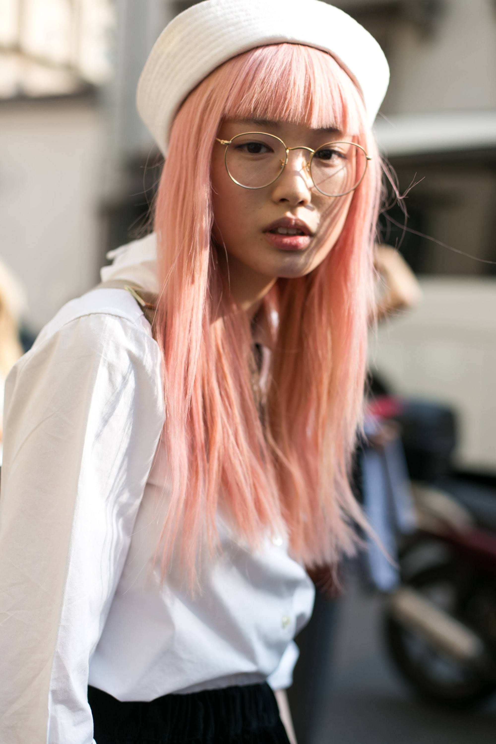 young woman with long peach hair with blunt bangs