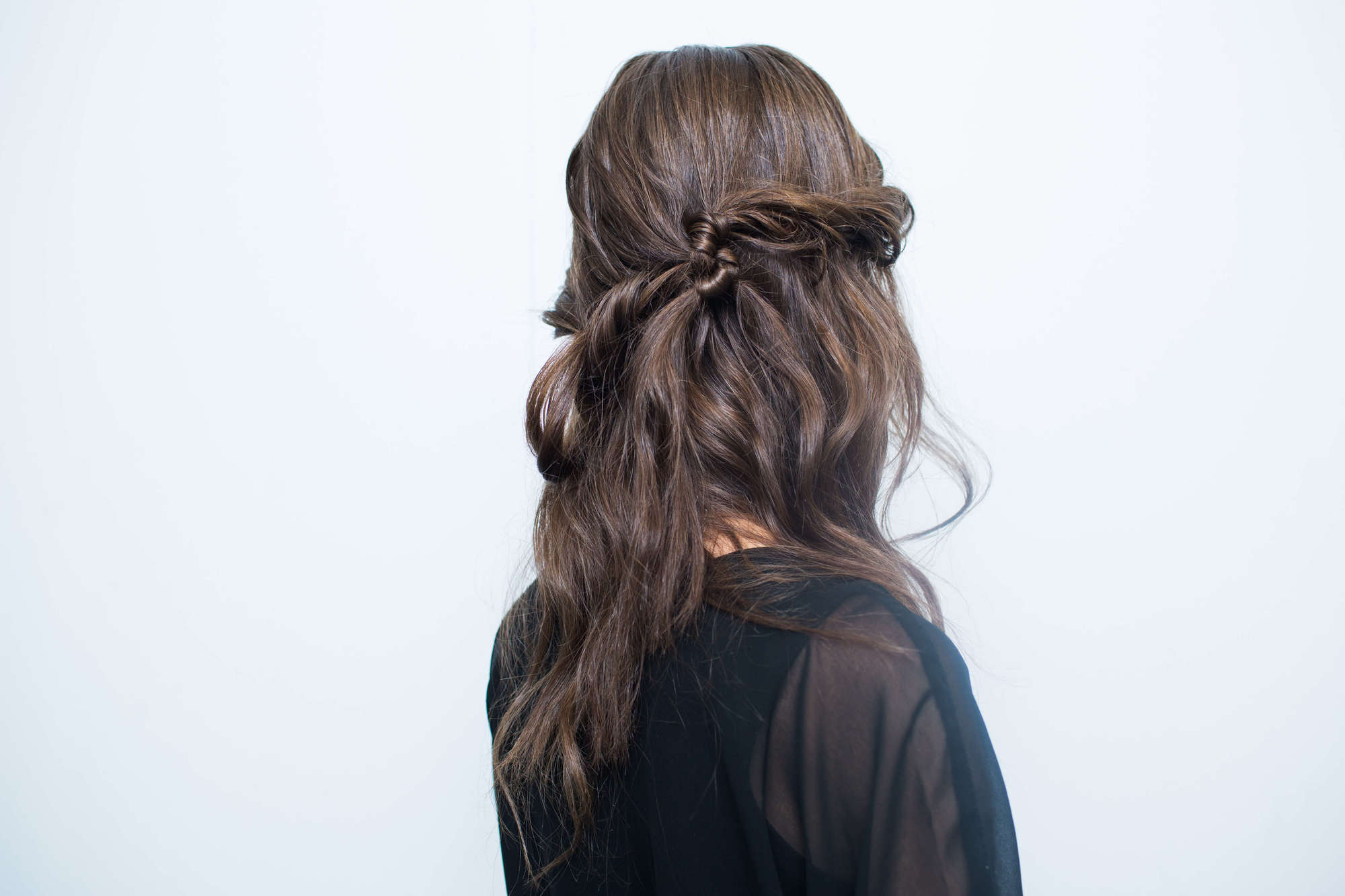 red carpet updo hairstyles for prom: knitted bangs