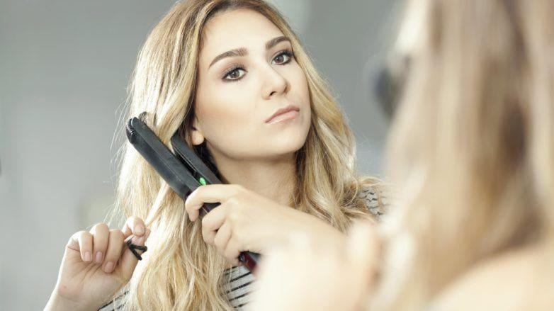repair hair blonde woman straightener