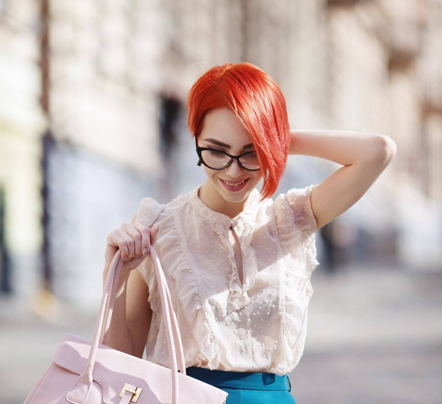 when it comes to short funky hairstyles, an asymmetric as demonstrated by this model with red short hair is very popular