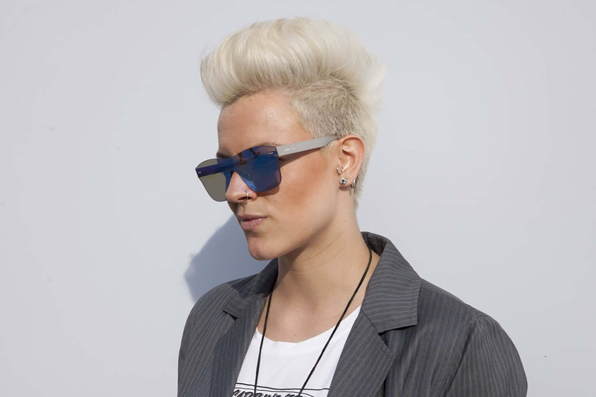 woman with short spiky haircut in platinum blonde