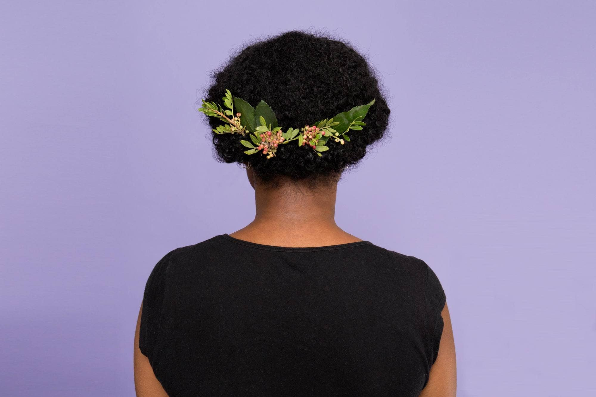 Simple updo ideas you can wear to prom. Croissant bun with floral accessory.