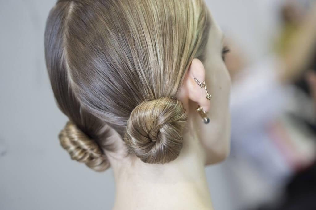 sleek hair trend with space buns