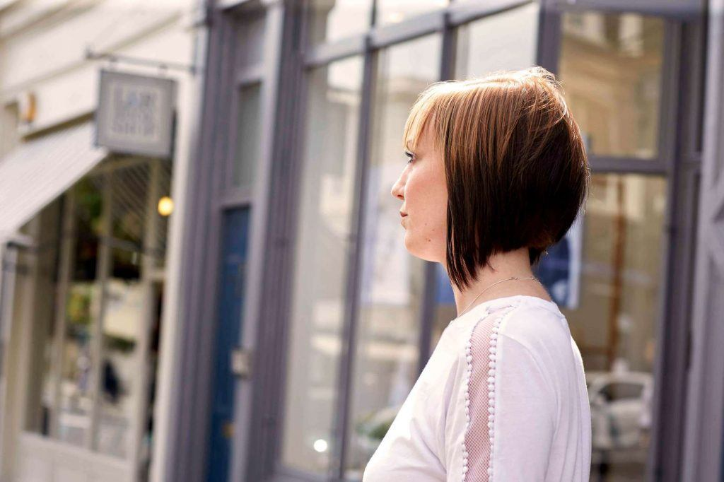 woman with short stacked hair bob hairstyle with asymmetrical cut
