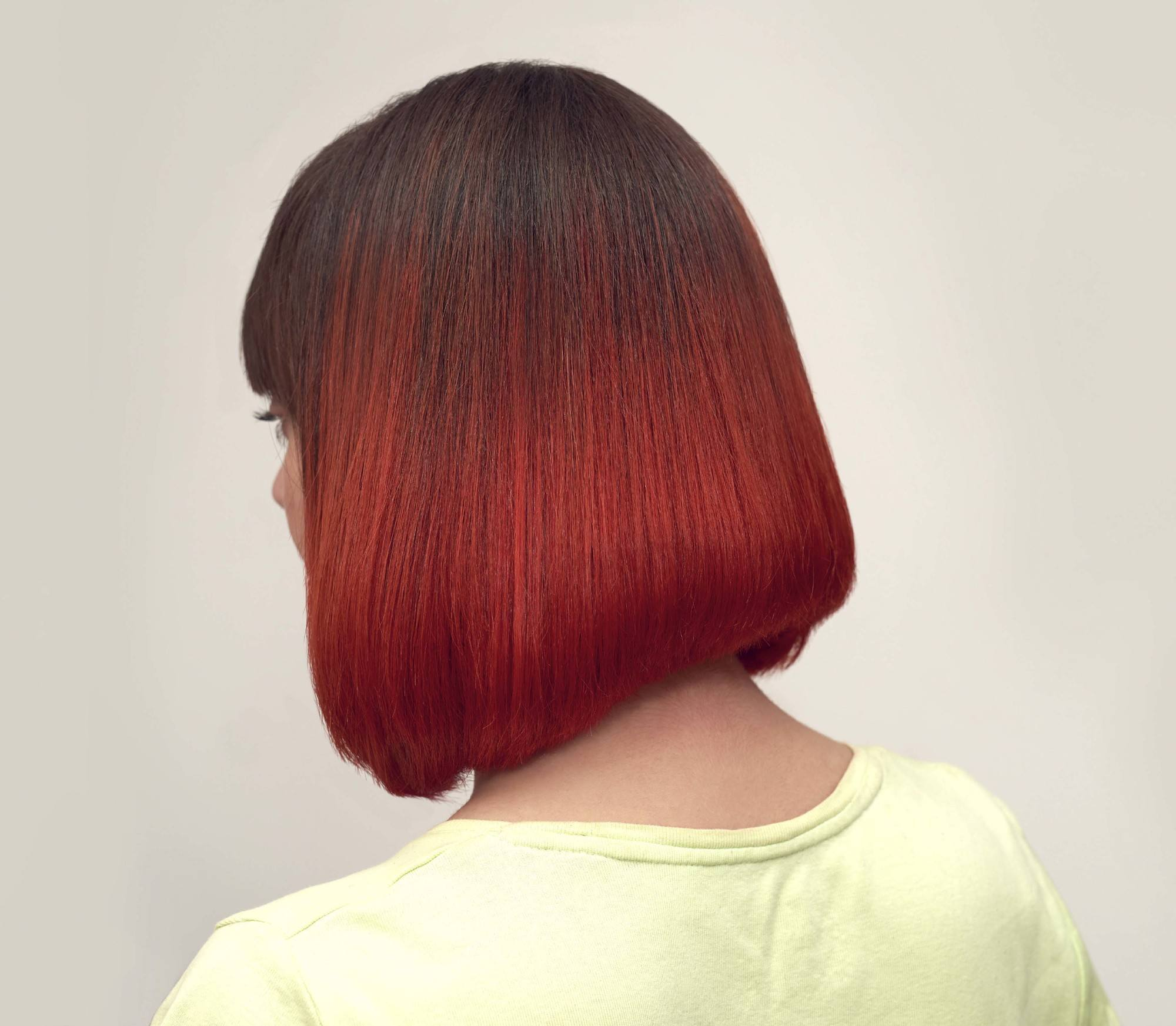 woman with stacked hair bob with bold red ombre