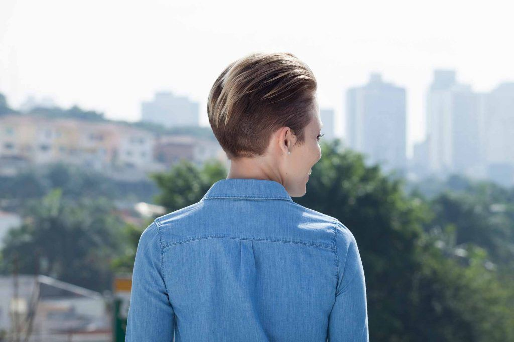 woman with pixie hairstyle combed back