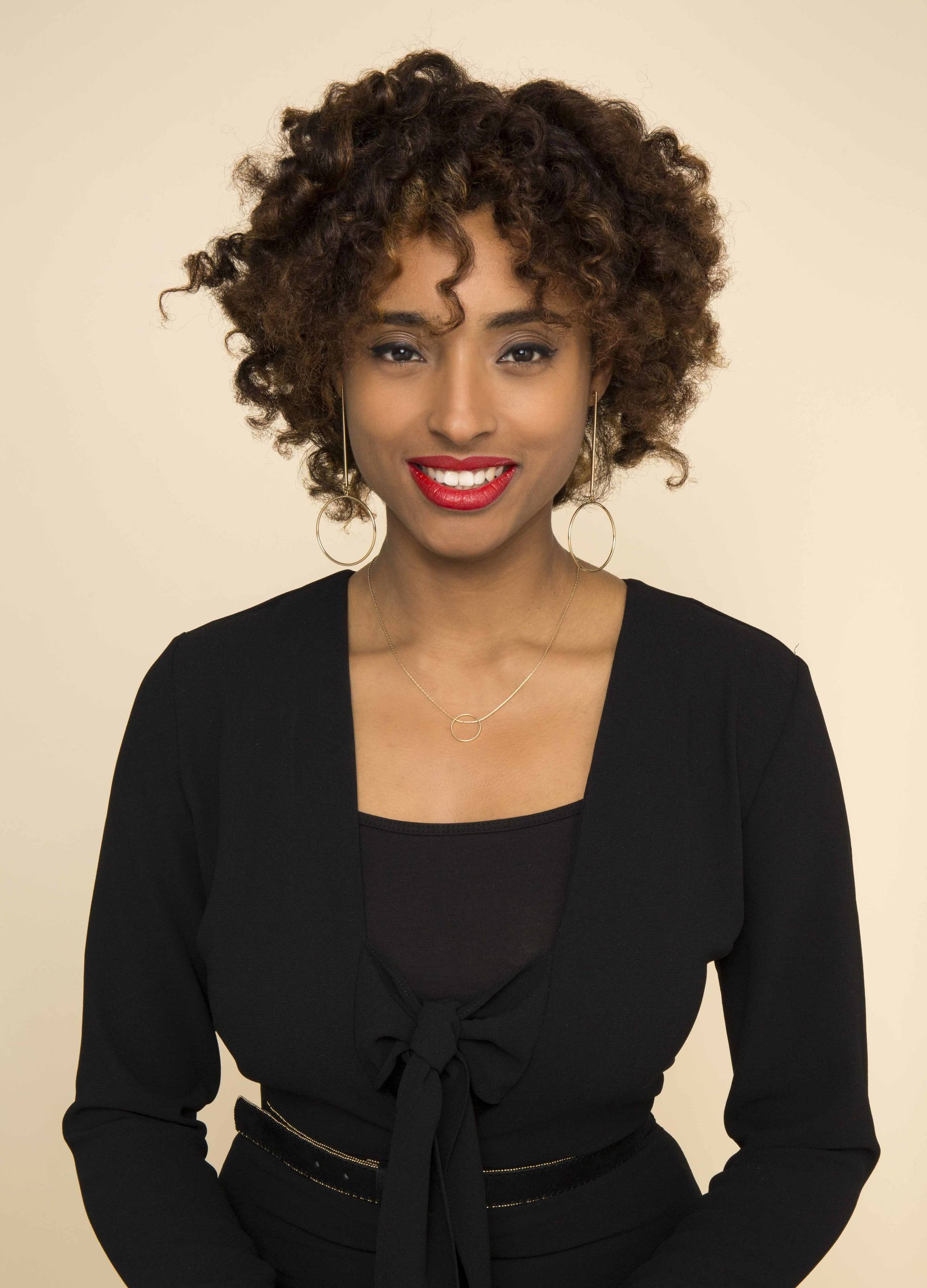 transitioning hairstyles to grow out chemically straightened hair: Bantu curls.