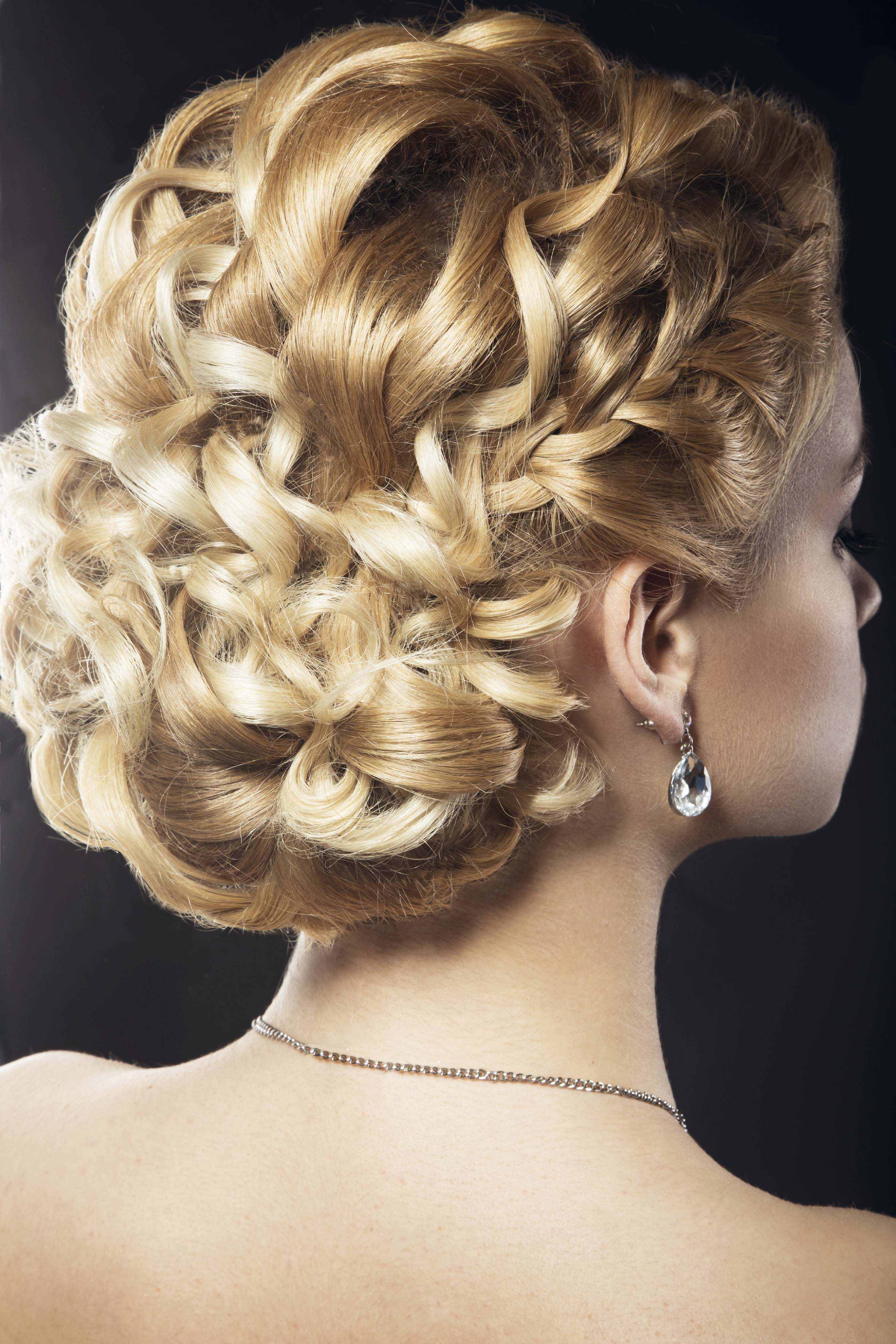 Wedding Updos For Curly Hair include loose romantic styles.