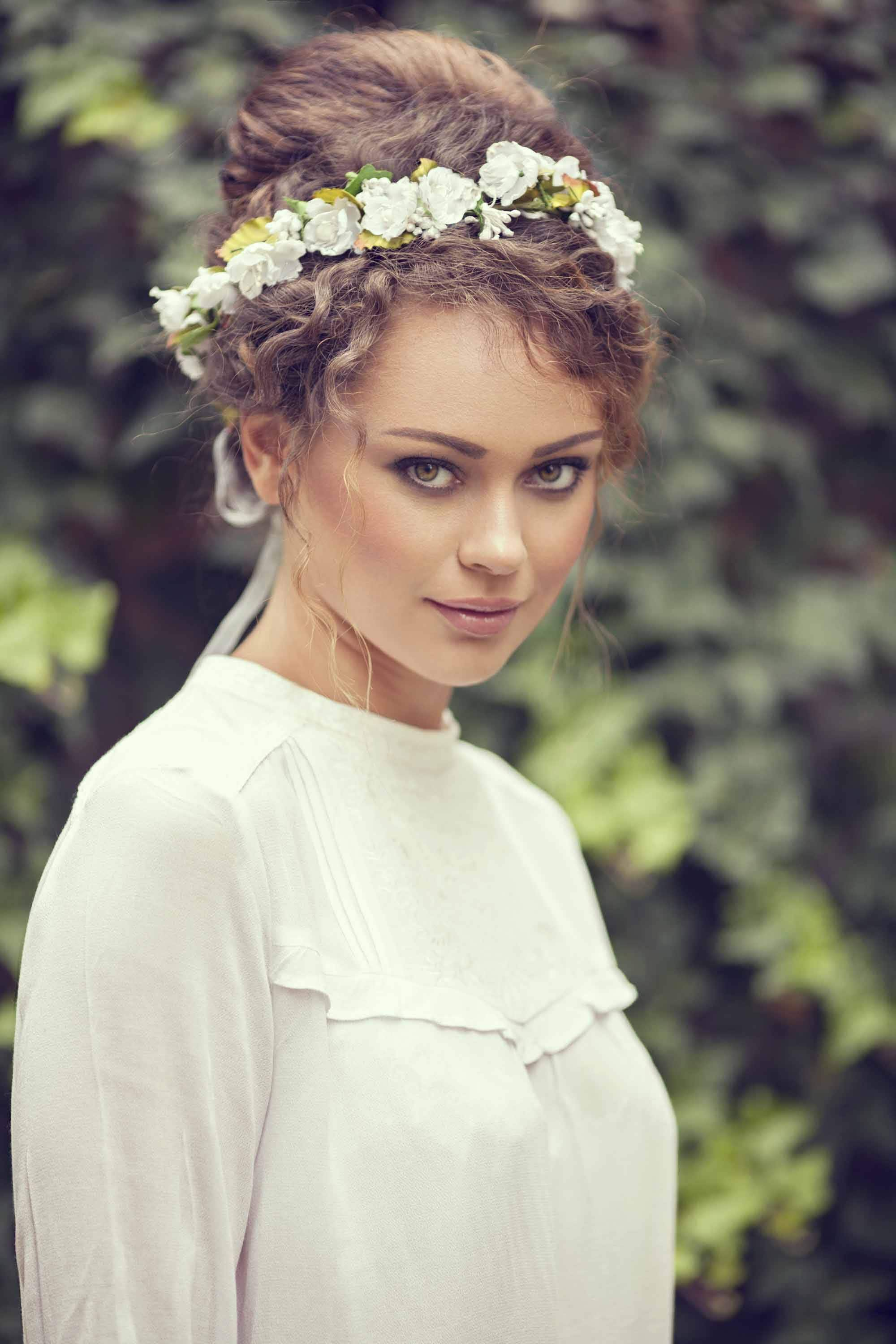 Wedding Updos For Curly Hair include high bun accented styles