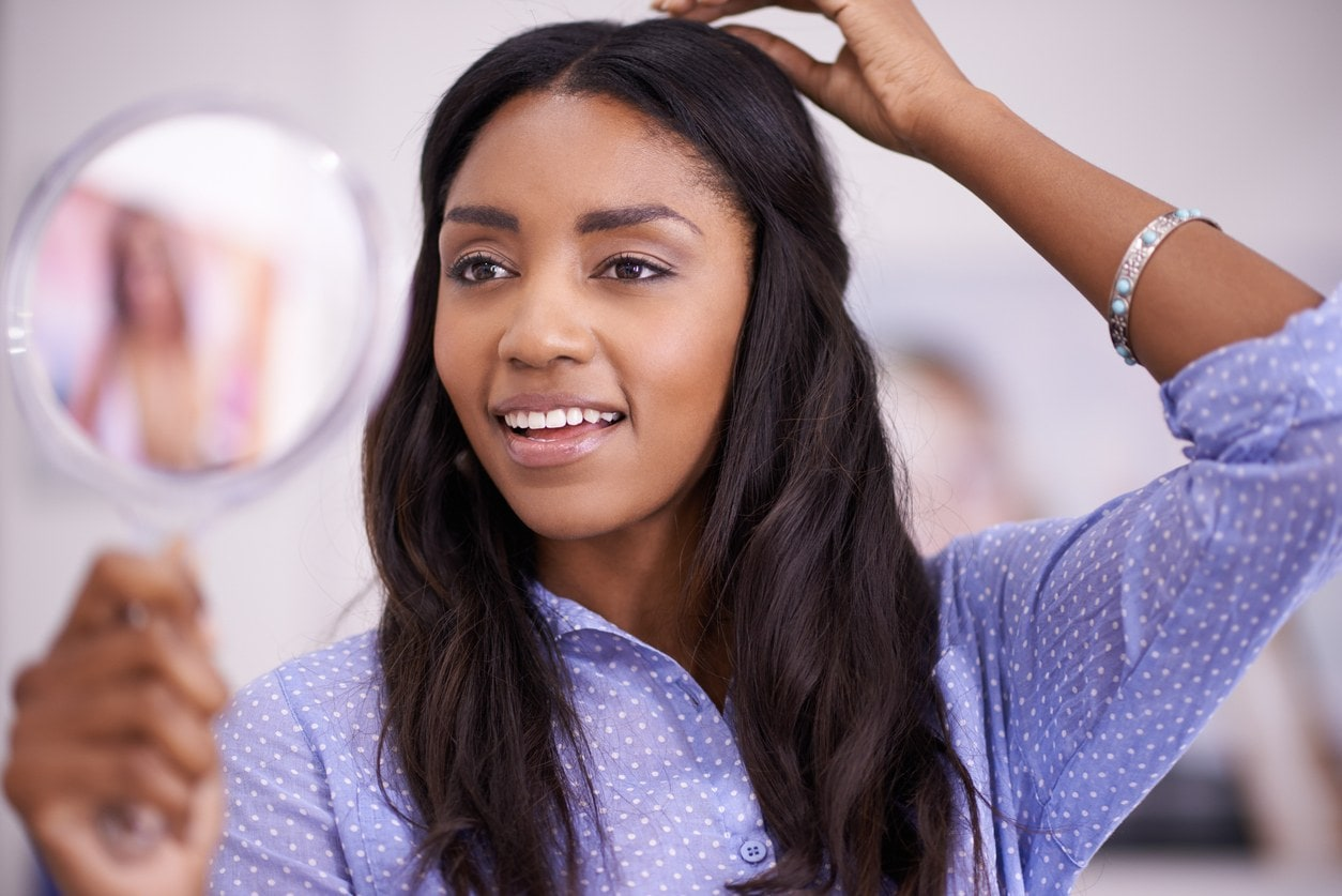 woman caring for hair extensions