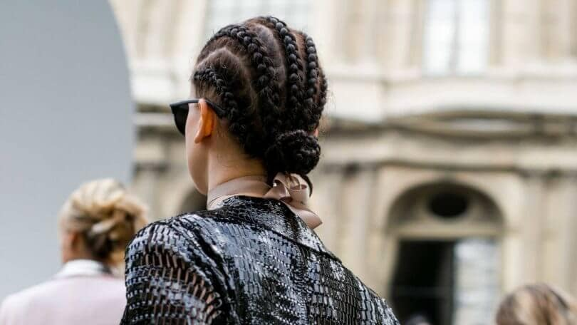 large cornrows low bun in the back