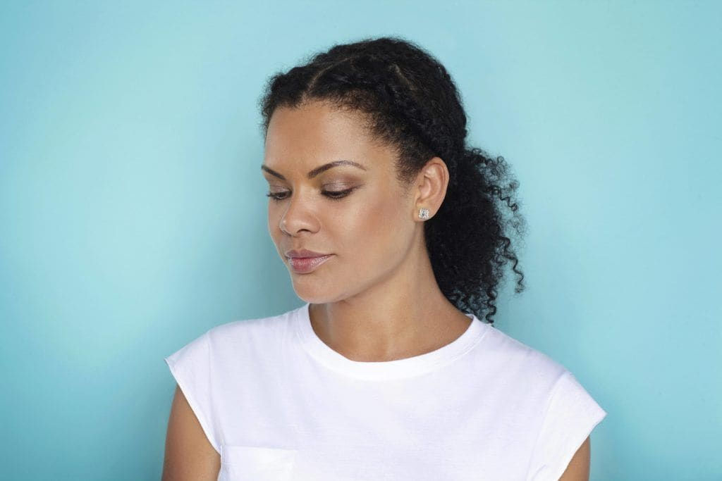 woman showing popular natural braided hairstyle