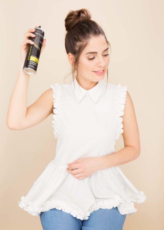 how to do a topknot bun apply hairspray