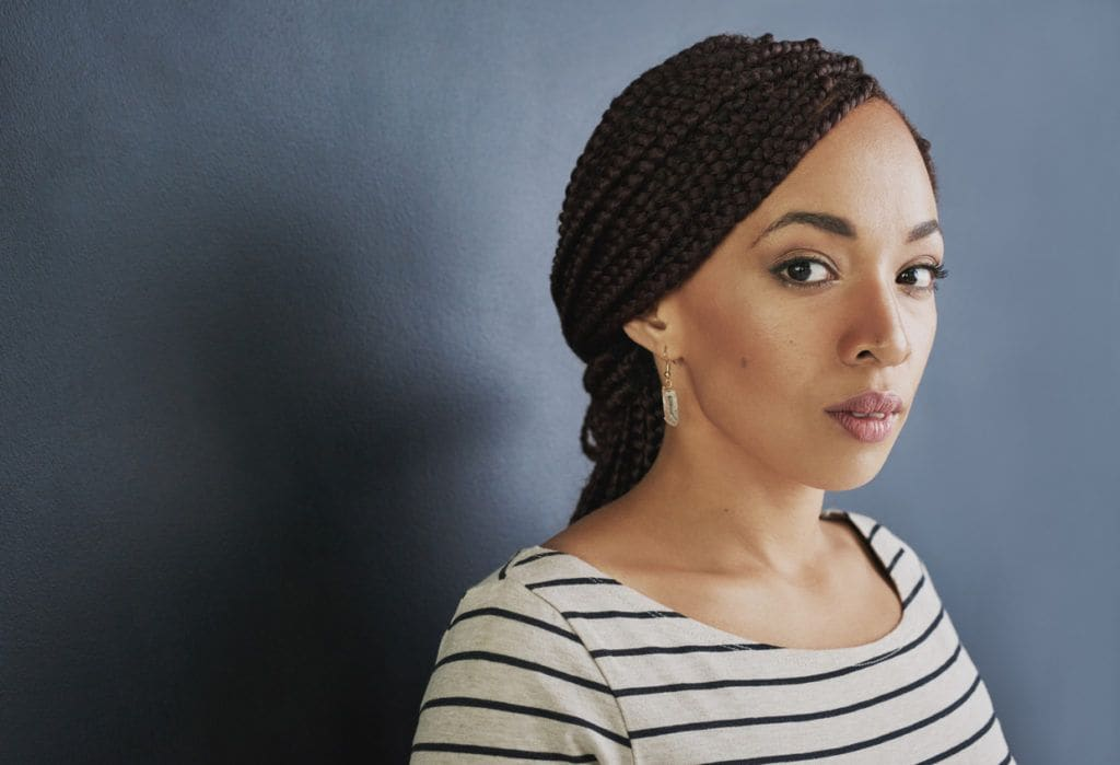 a side view of a black woman with braided ponytail