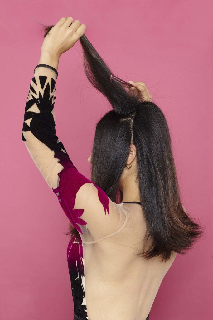 elegant ponytail: section and tease