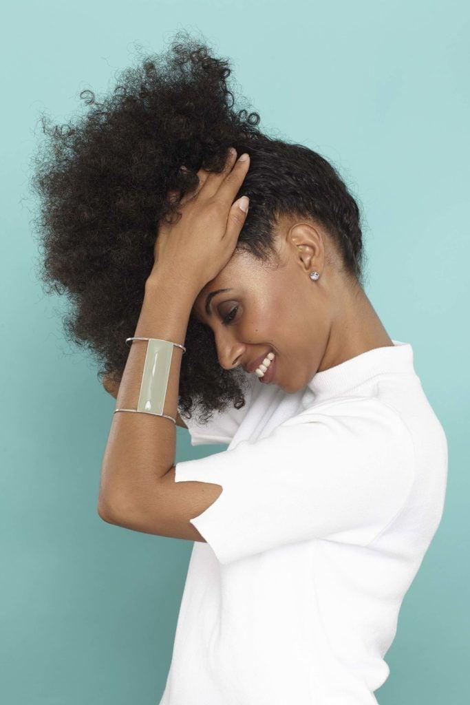 hair puff natural hair: gather hair into ponytail