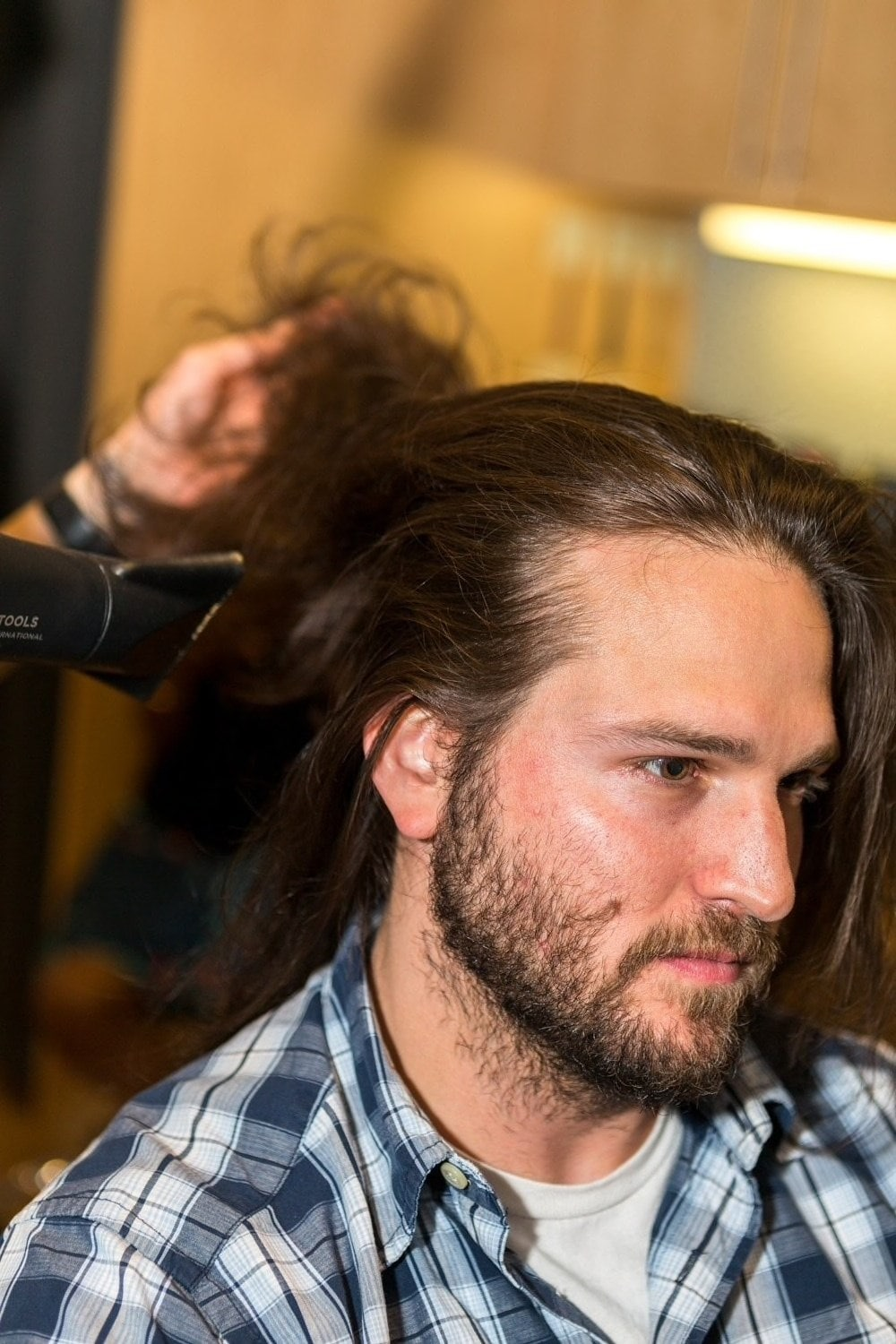 how to do a man bun starts with blowdrying your hair