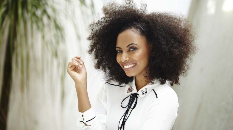 side pinned hairstyle on natural hair