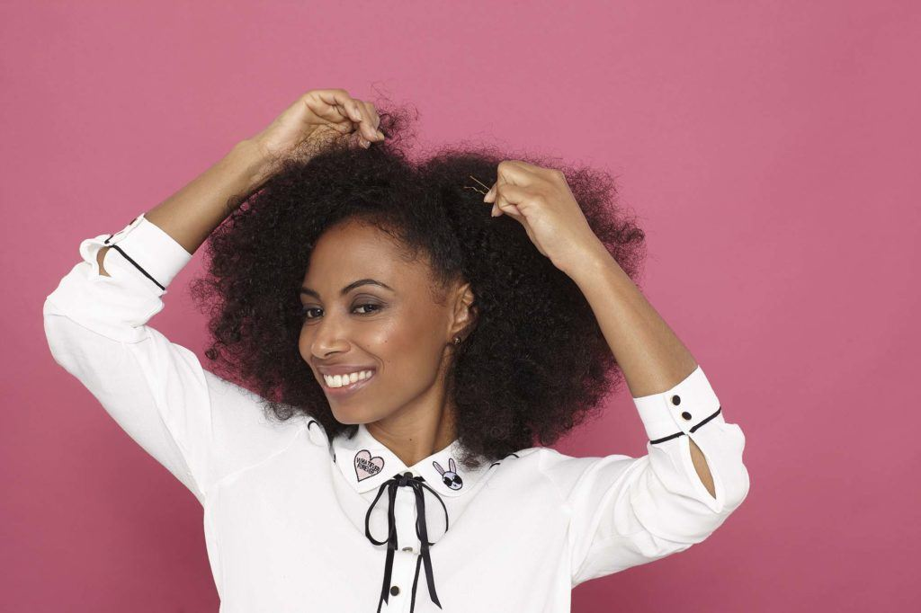 side pinned hairstyle for natural hair add pins