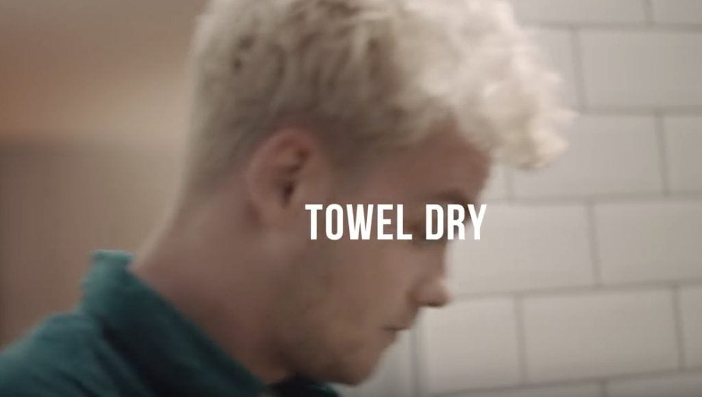 style a receding hairline: towel dry hair