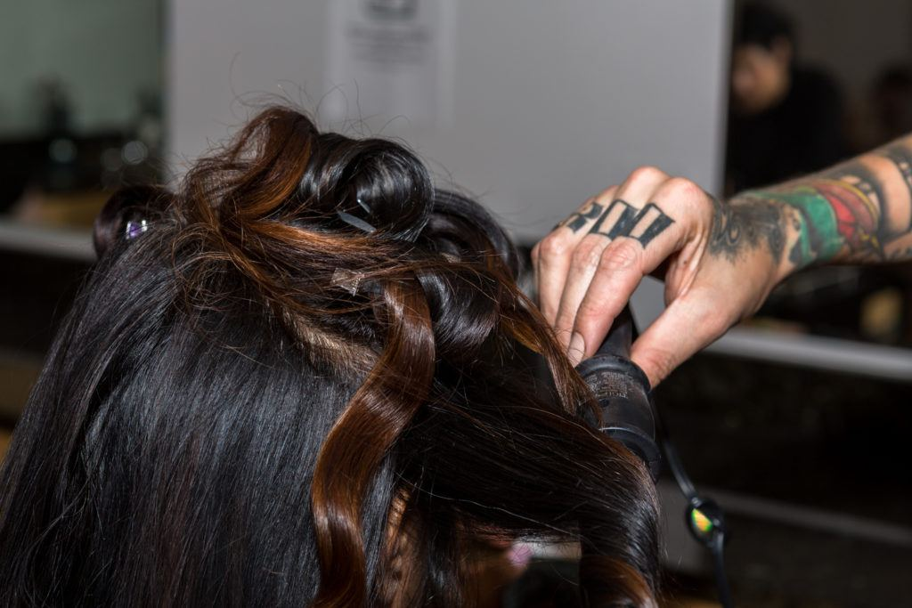 using a curling wand on the back sections