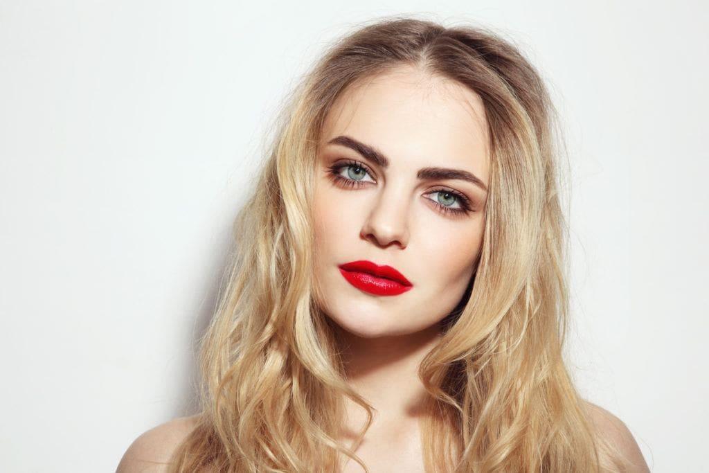 rooty blonde balayage curly hair
