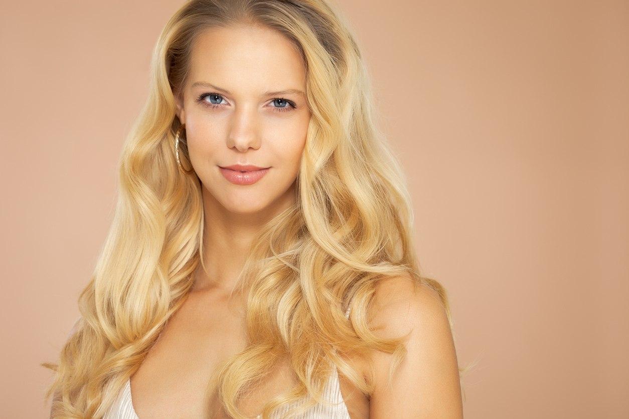 sunny blonde balayage curly hair