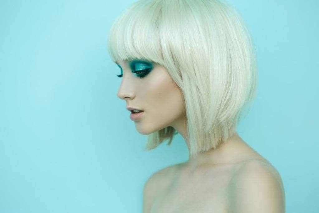 side view of a girl with rounded short bleached hair