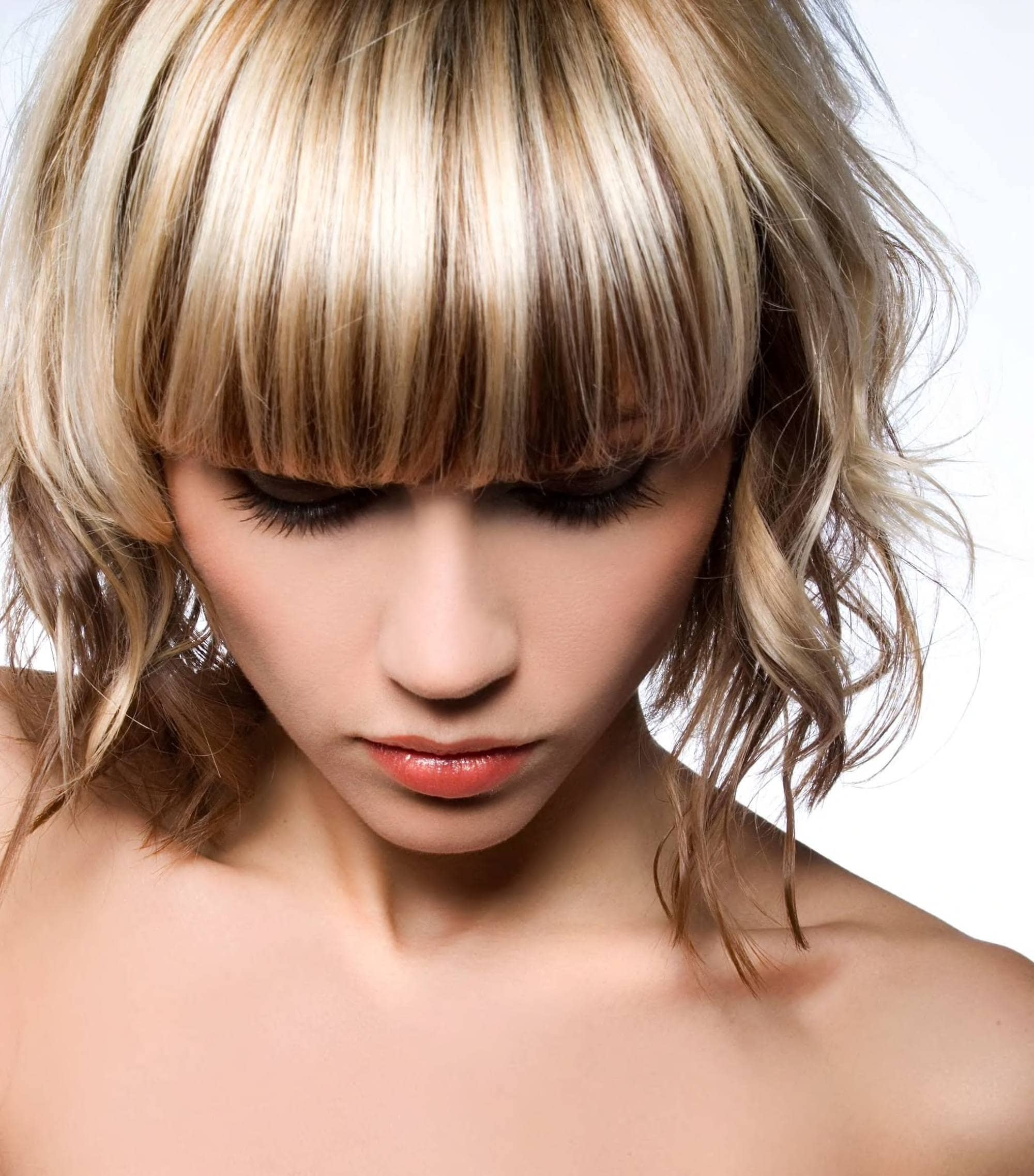 brown hair with blonde highlights with bangs