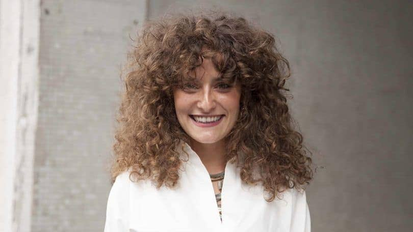 volume with curly hair bangs
