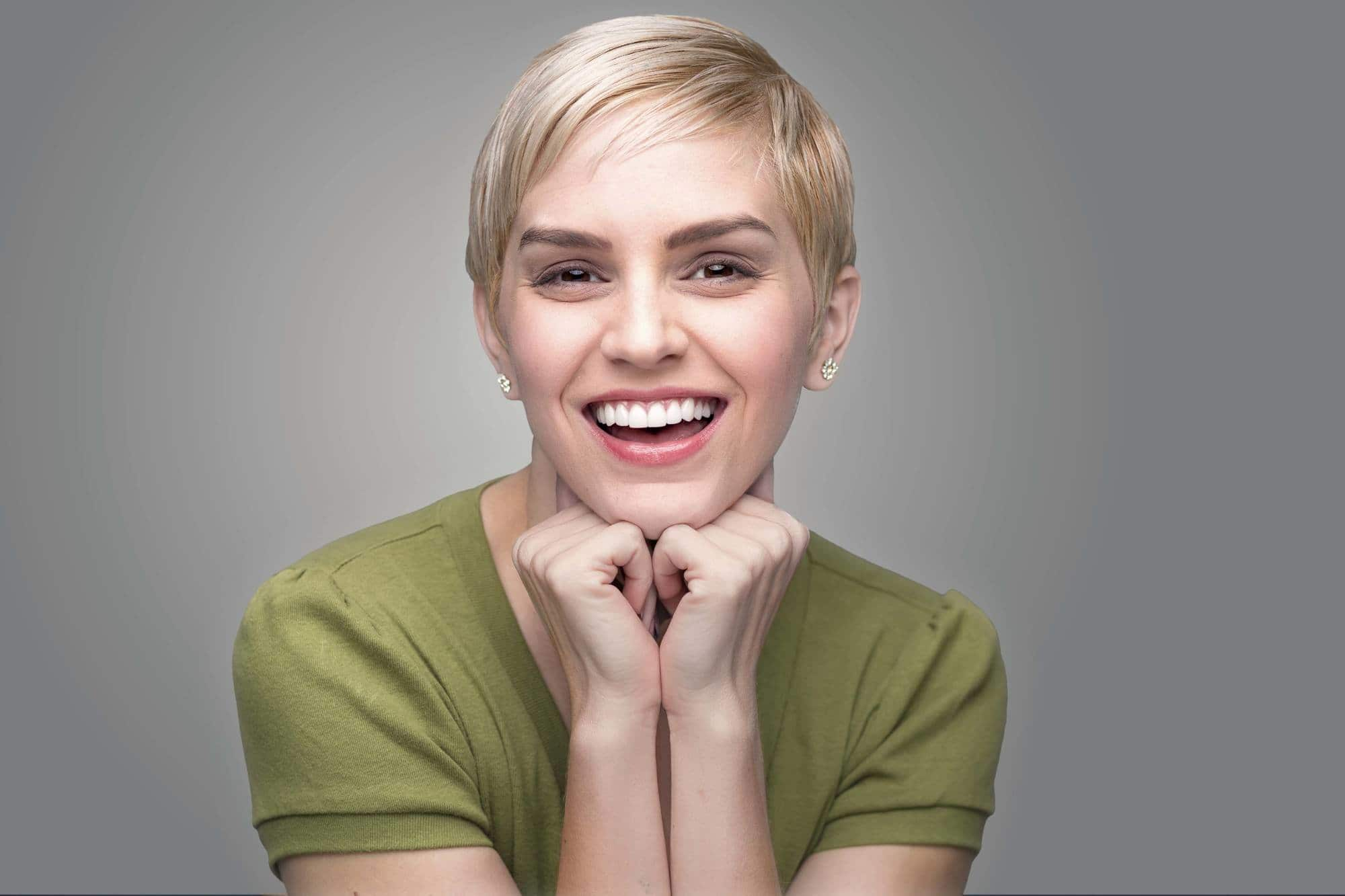 haircuts for round faces sleek pixie