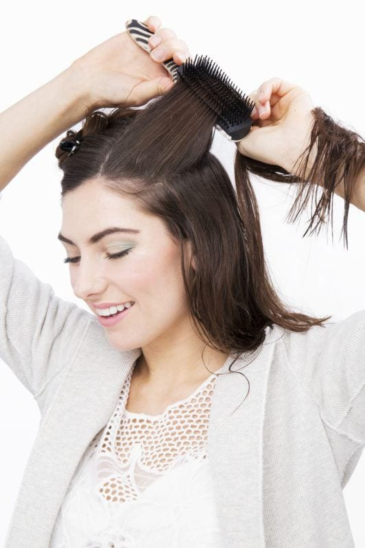 how to straighten hair use a brush