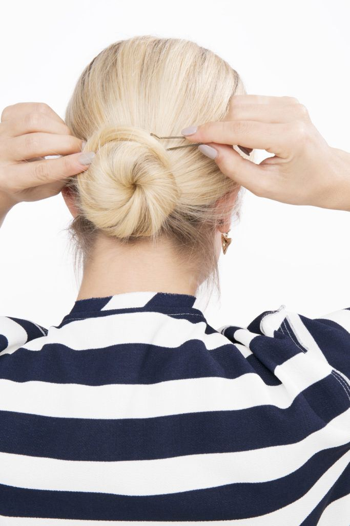 low chignon tutorial secure with hairpins