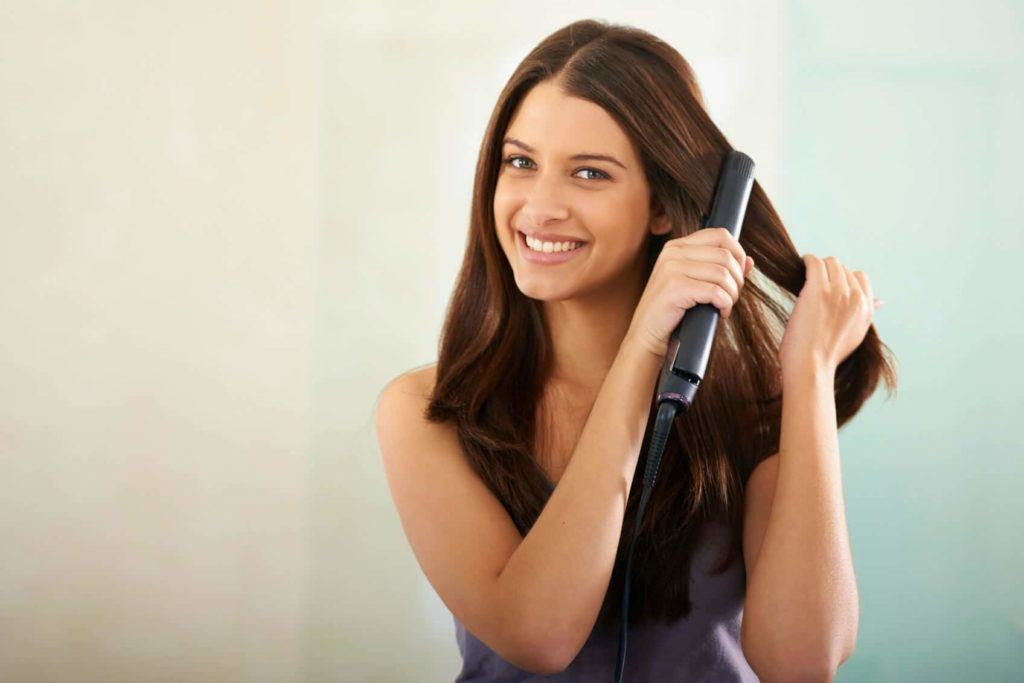 Flat iron hair for a smooth, sleek look.