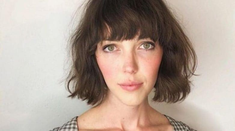 girl with wavy hair and bangs