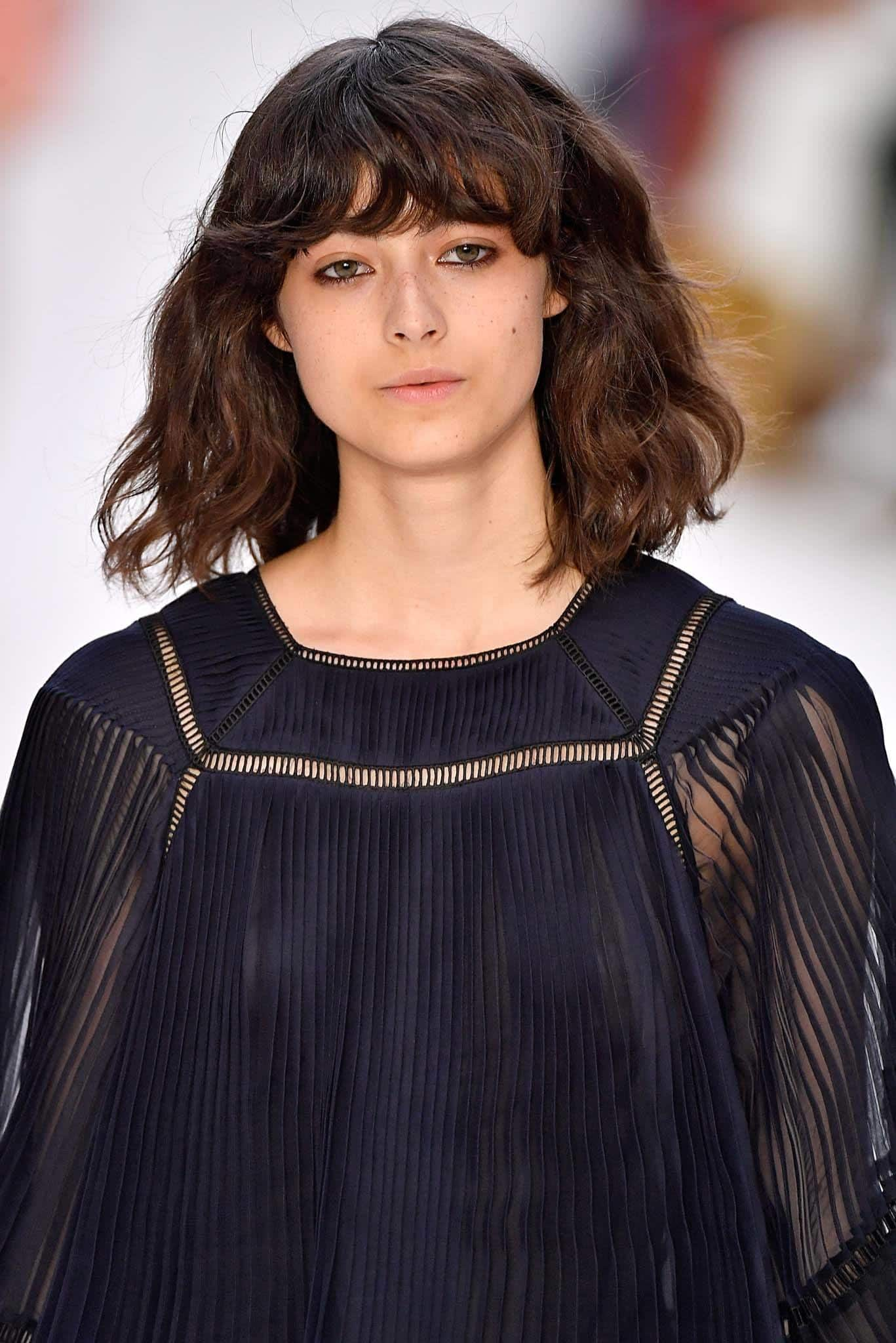 beachy lob with bangs best haircuts for curly hair