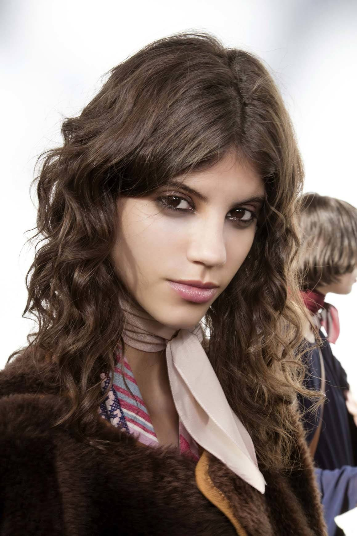 middle parted shag best haircuts for curly hair