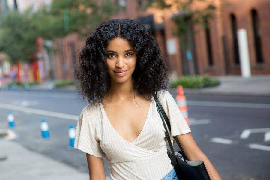 center parted natural lob best haircuts for curly hair