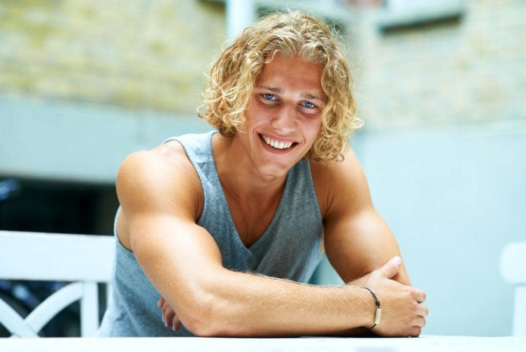 hairstyles for men with thick curl hair blonde surfer curls