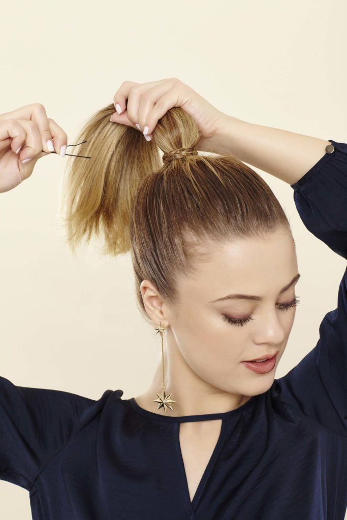 secure the high ponytail braid with a pin