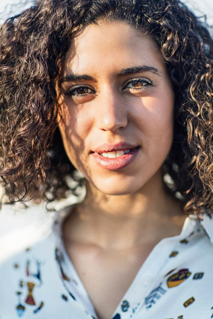 close up look of a beautiful curly woman