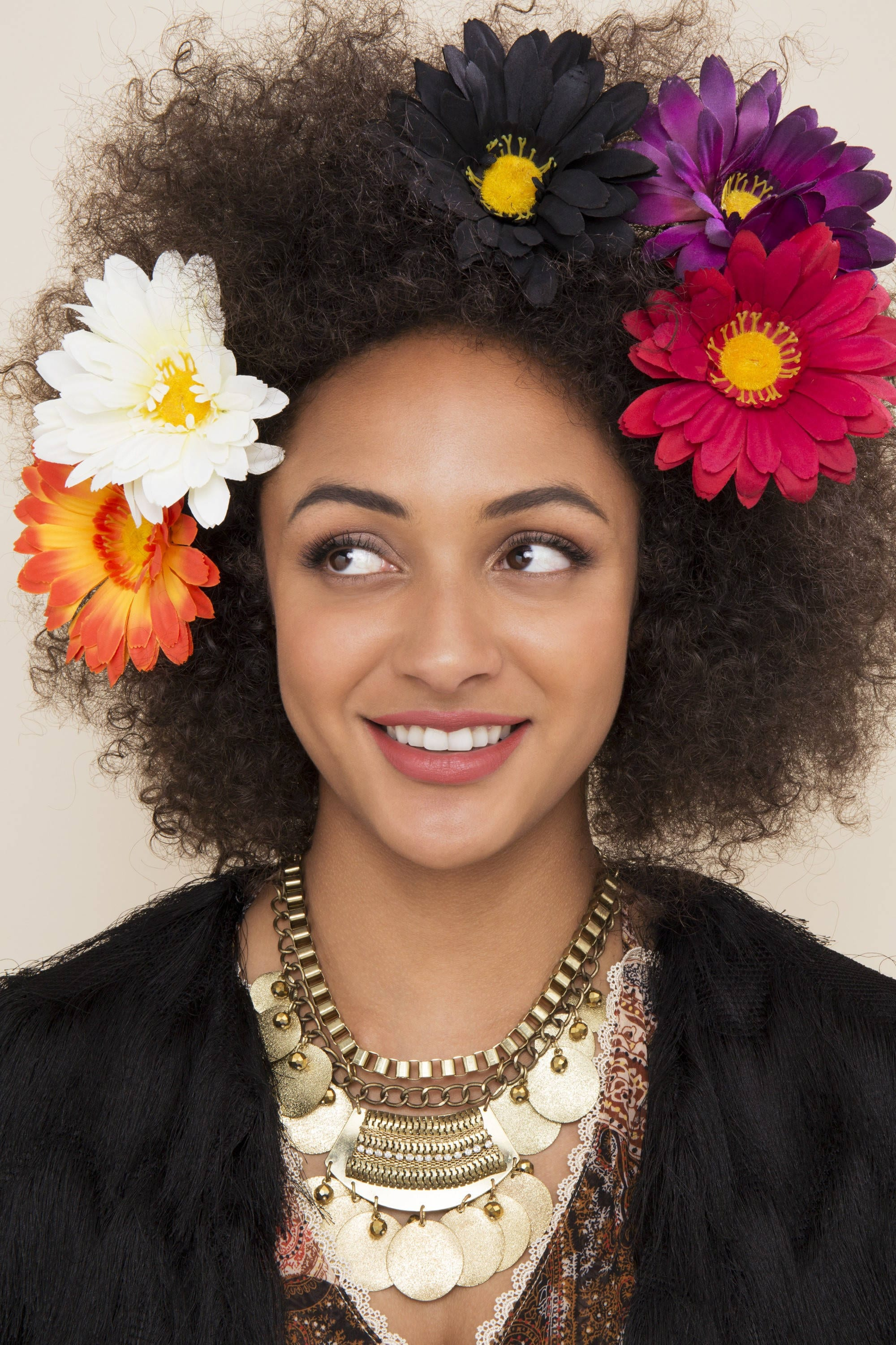 summer hairstyle trends: festival hair floral afro