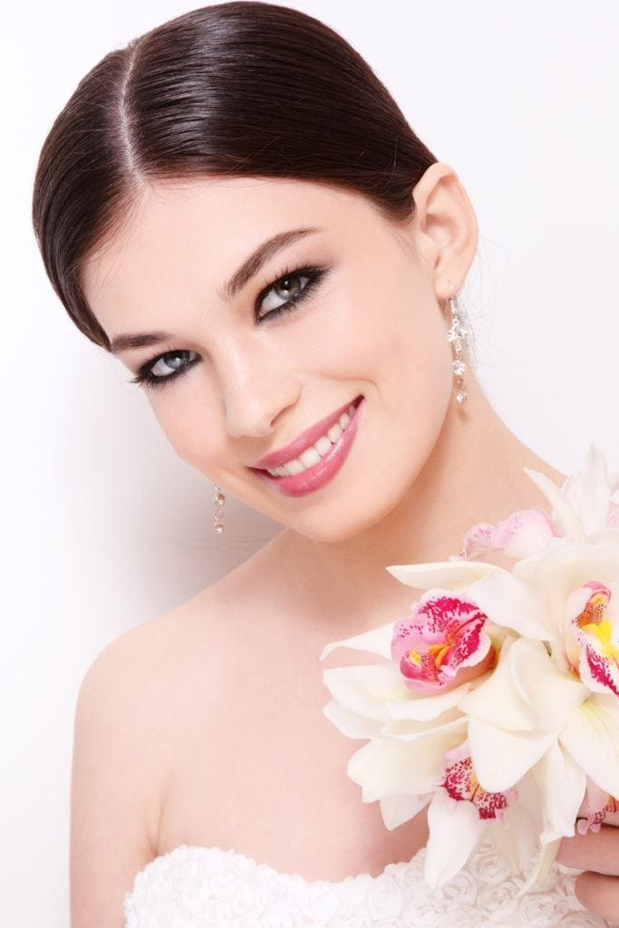 sleek center part wedding updos for long hair